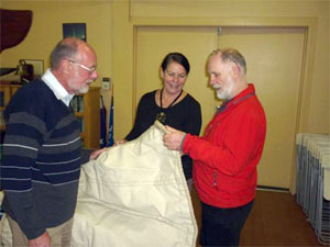 Peter Batchelor, with Tony and Linda Remington, examining one of sails